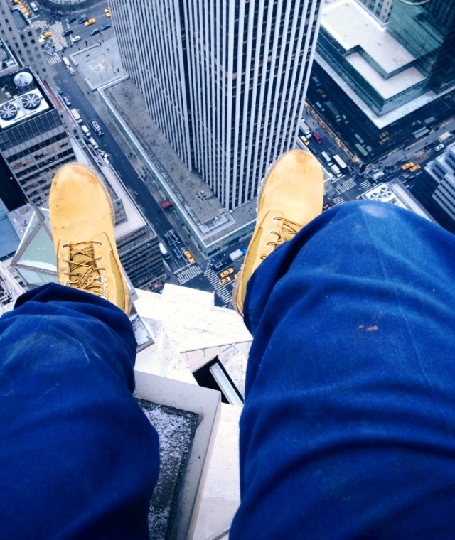 Just sitting on the edge of a skyscraper's roof