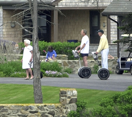 George W. Bush and his father chase Barbara Bush on segways