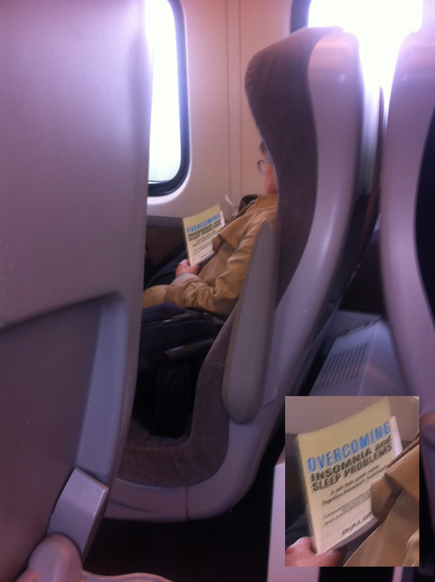 Woman asleep on train